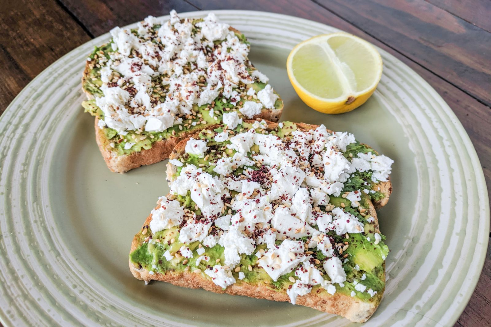 Avocado and feta toast with lime, sumac, and toasted sesame seeds