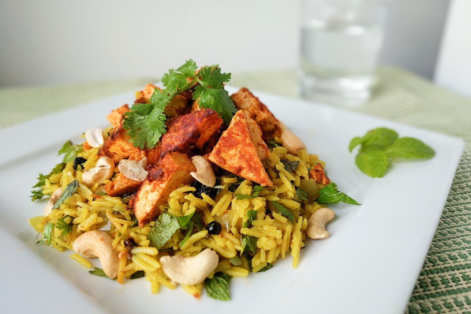Tandoori tofu with spiced Indian rice, fresh herbs, and cashews